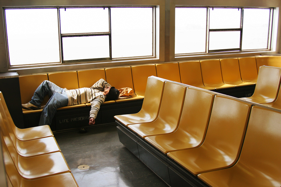 A Man Asleep on the Staten Island Ferry